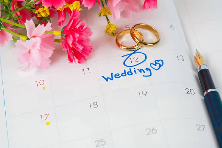 Calendar with wedding date marked along with two rings