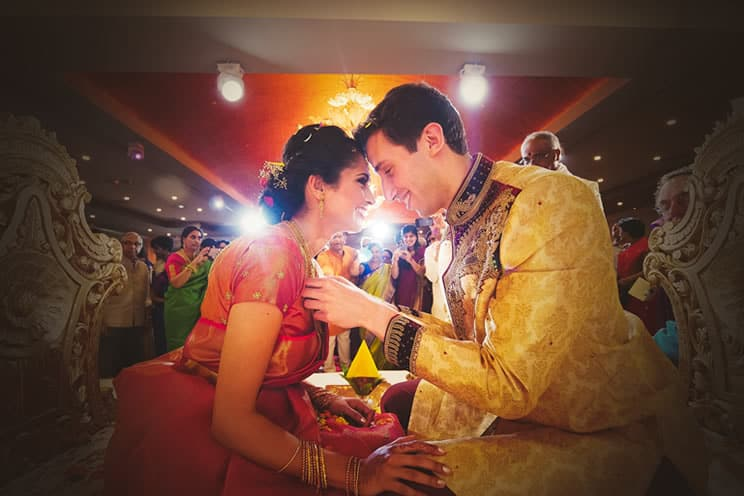 Indian couple looking into each others eyes at Indian wedding ceremony