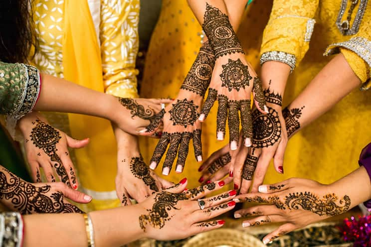 women with mehndi on their hands