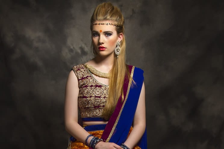 Caucasian woman dressed in Hindu wedding clothes