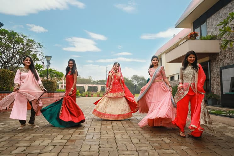 Indian women wearing different dresses for indian wedding