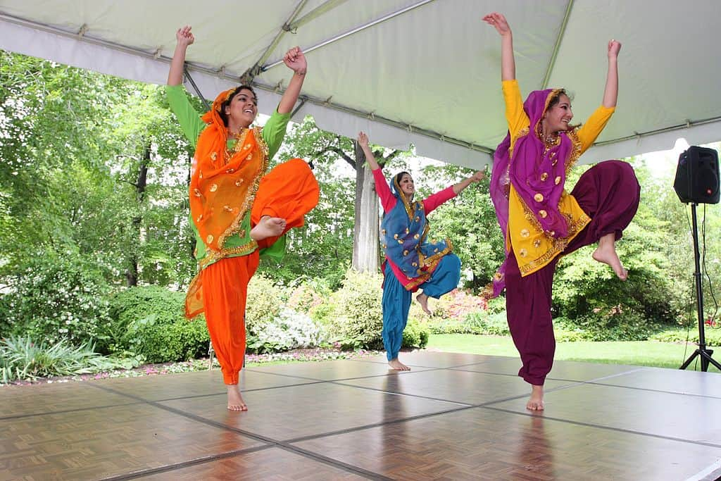 Women dancing on a stage for a Sangeet