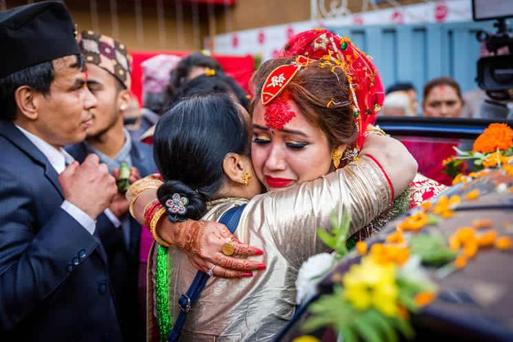 Indian bride embracing mother and crying